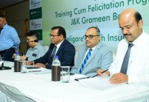 Guests during a programme organized by J&K Grameen Bank in association with Religare Health Insurance.