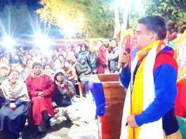 BJP State president, Ravinder Raina addressing an election rally in Leh on Friday.