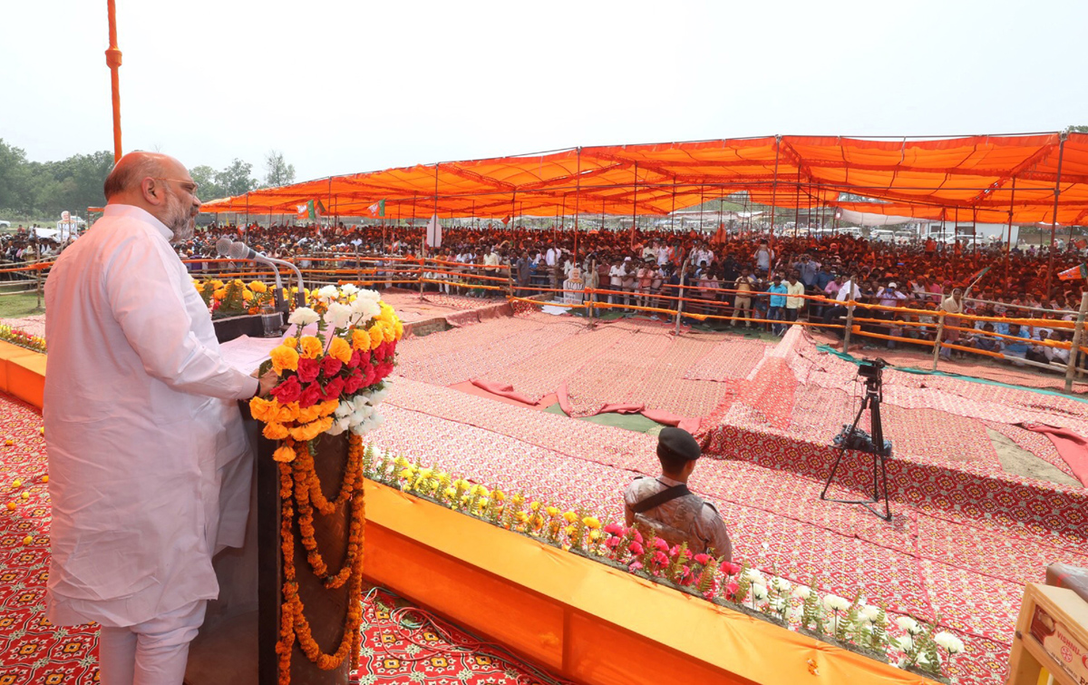 BJP National President Amit Shah addressing a public meeting during 7th and last phase of Lok Sabha polls, in Maharajganj in Uttar Pradesh on Thursday. (UNI)