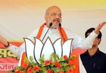 BJP National President Amit Shah addressing an election rally, at Siddharthnagar in Uttar Pradesh on Thursday. (UNI)