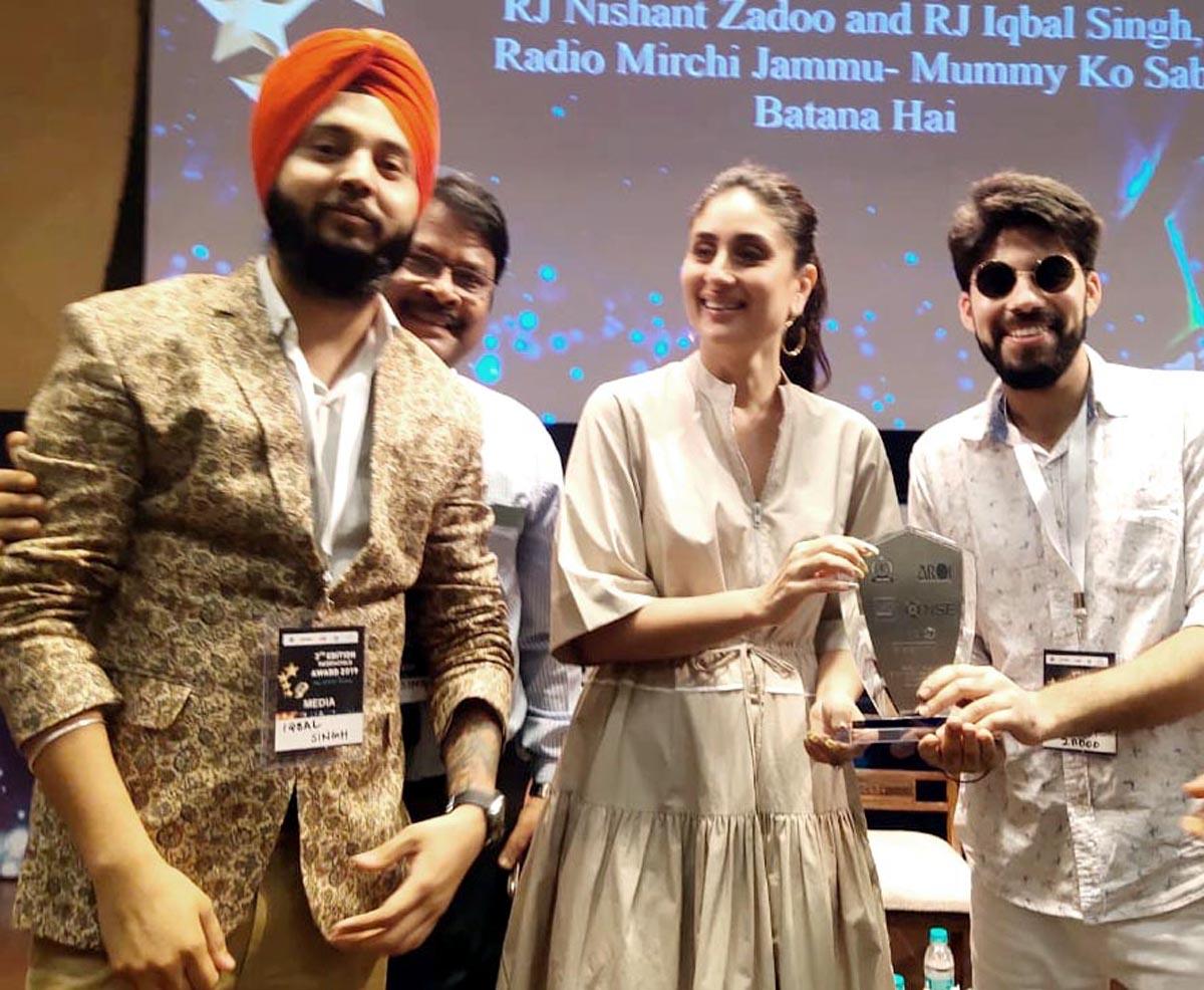 RJ Nishant Zadoo and RJ Iqbal Singh of Radio Mirchi Jammu receiving award from actress Kareena Kapoor Khan at Mumbai.