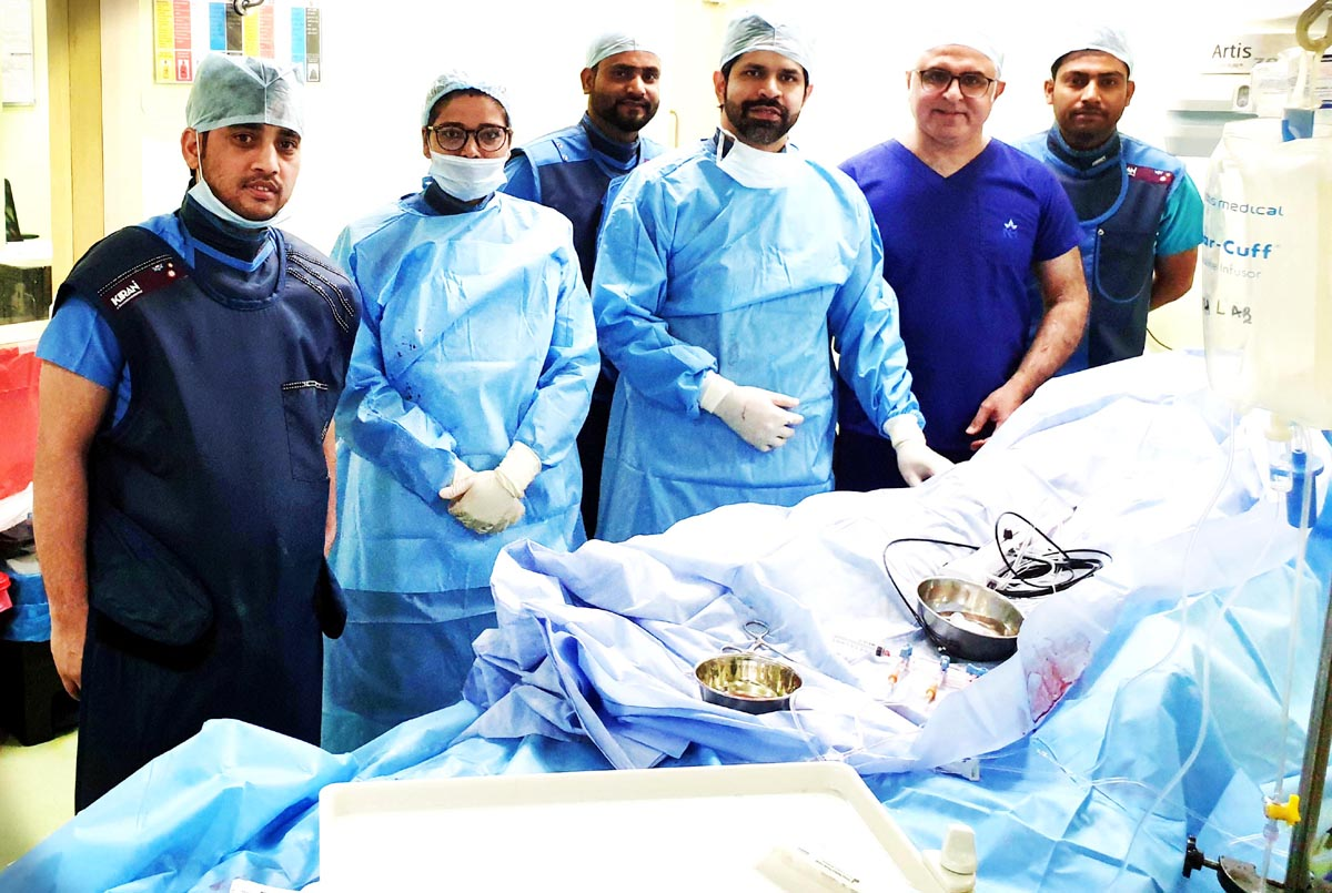 A team of doctors of SMVD Narayana Hospital Kakryal posing after performing surgeries on two war veterans.
