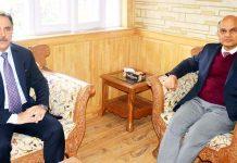 Advisor K.K Sharma meeting Chairman J&K Bank Parvez Ahmed in Srinagar on Friday.