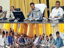 Divisional Commissioner Jammu Sanjeev Verma chairing a meeting at Ramban on Friday.