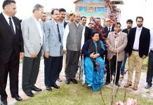 Chief Justice Gita Mittal and others during plantation drive at District Court Complex Mominabad in Srinagar.