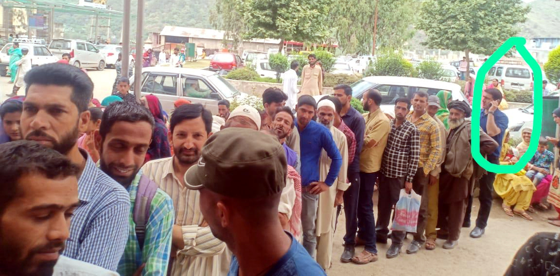 DC Rajouri Mohd Aijaz Asad (in circle) standing in queue to get registration slip as comman man during surprise visit at District Hospital. -Excelsior/Bhat