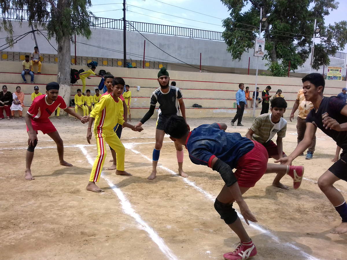Players in action during a Kabaddi final match at MA Stadium, Jammu on Thursday.