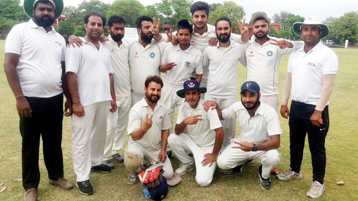 Players of Royal Warrior Cricket Club posing for a group photograph along with officials in Jammu on Thursday.