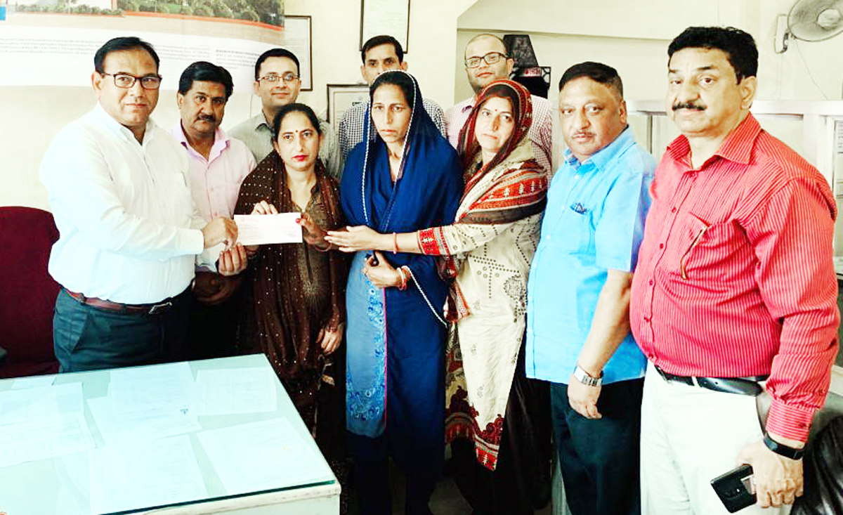 Janak Raj Angural, Chairman JKGB, presenting a cheque to a beneficiary of UMEED scheme in Samba district.