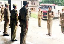 DG Fire and Emergency Services VK Singh taking guard of honour during inspection of a fire station in South Kashmir.