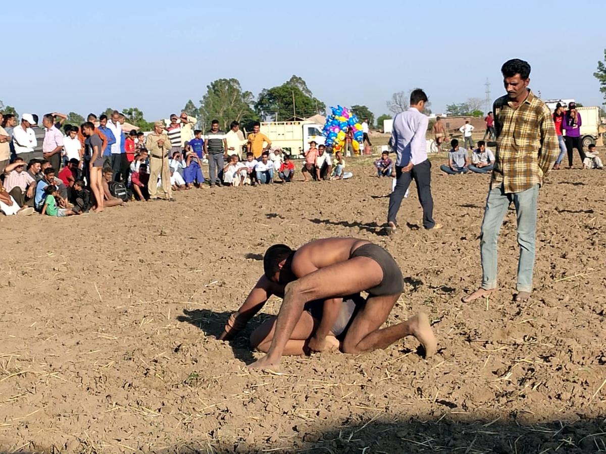 Wrestlers in action during annual Dangal at Village Chorli in Bishnah.