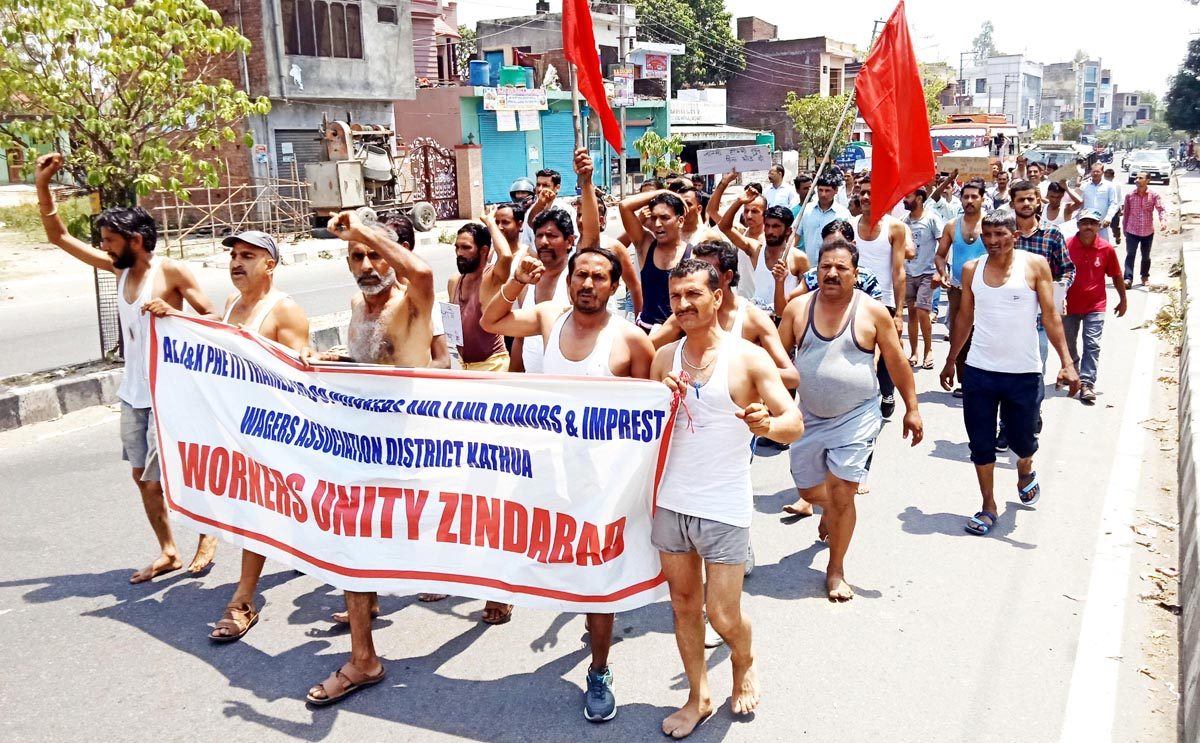 PHE daily wagers taking out a protest march in Kathua on Friday. -Excelsior/Pardeep
