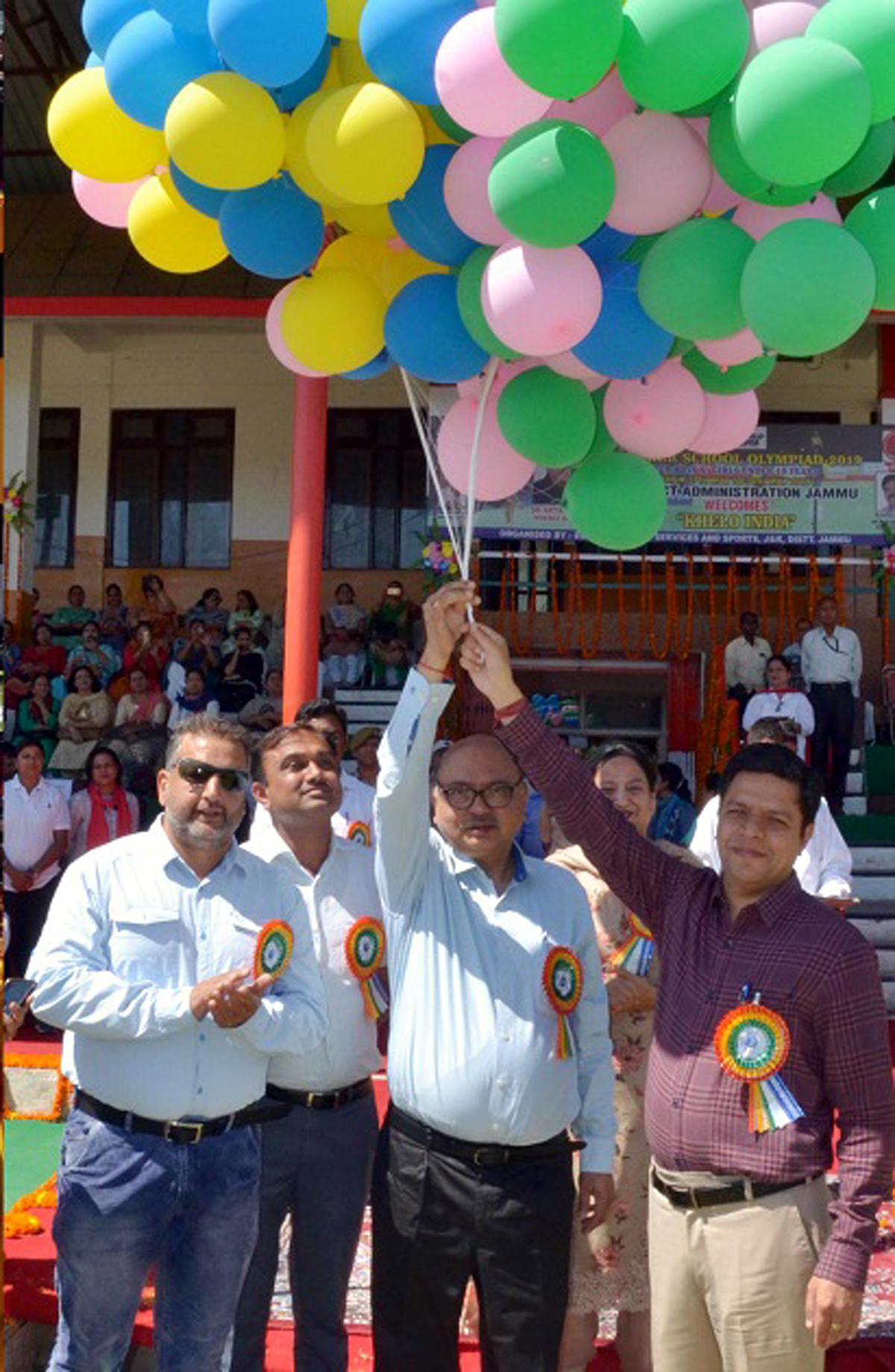 Advisor to Governor K Skandan and other dignitaries releasing balloons while inaugurating Summer School Olympiad in Jammu.