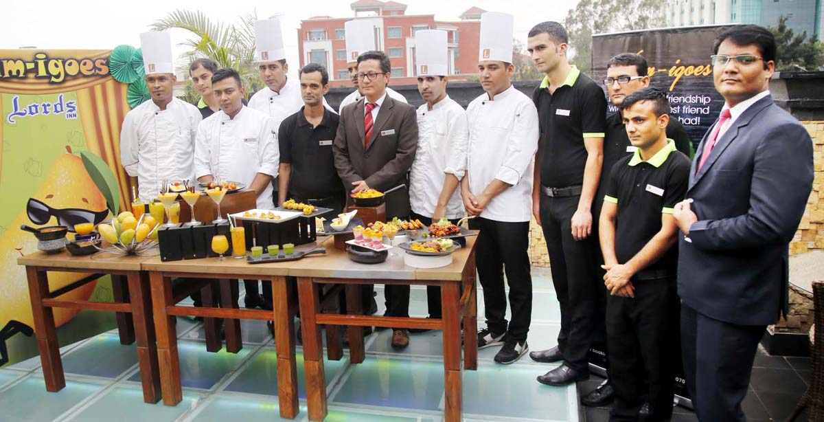 Officials and chefs of Grand Plaza Lords Inn Jammu showcasing cuisines to be served during 'Mango Festival'.