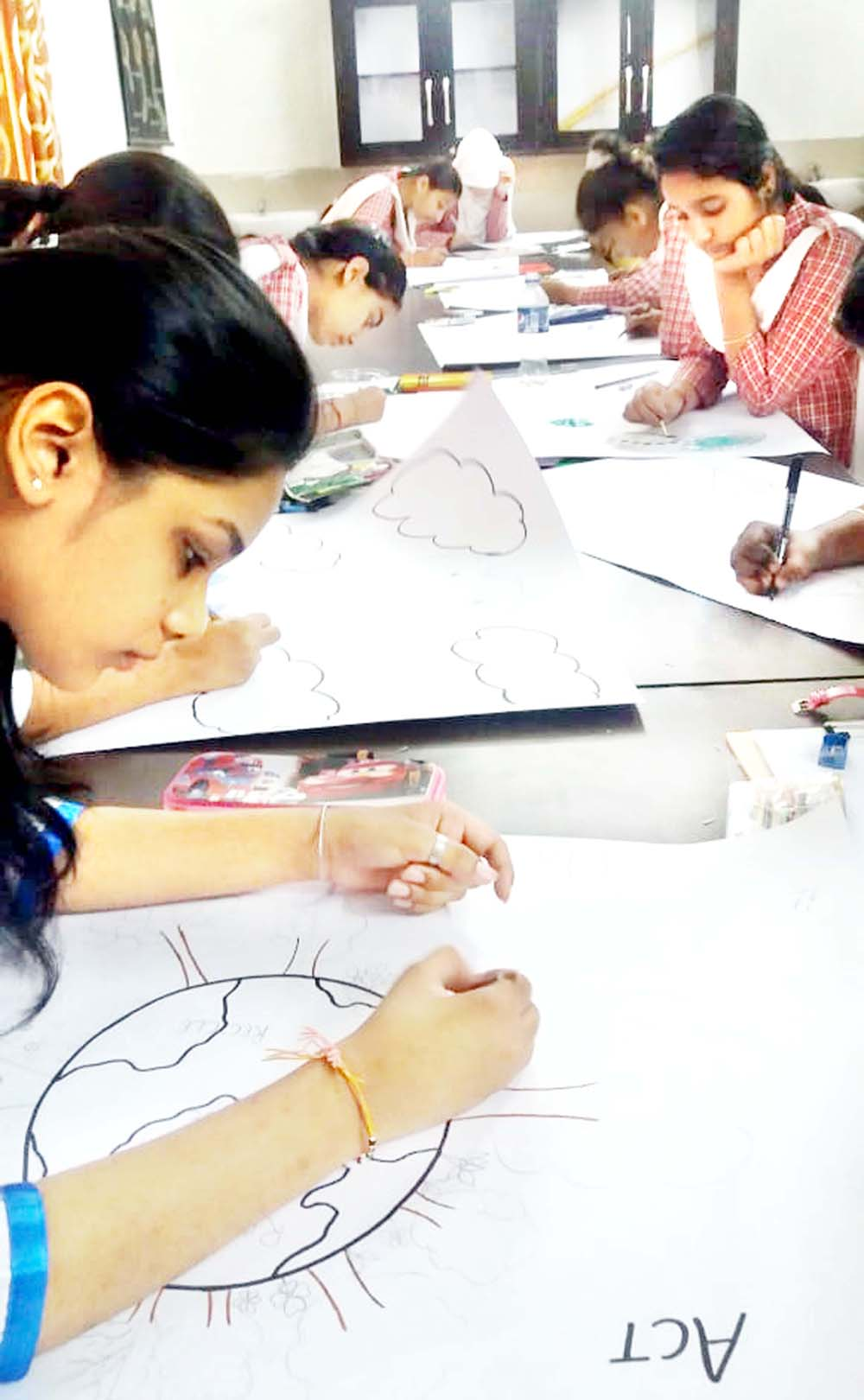 Students during painting competition at Jammu.