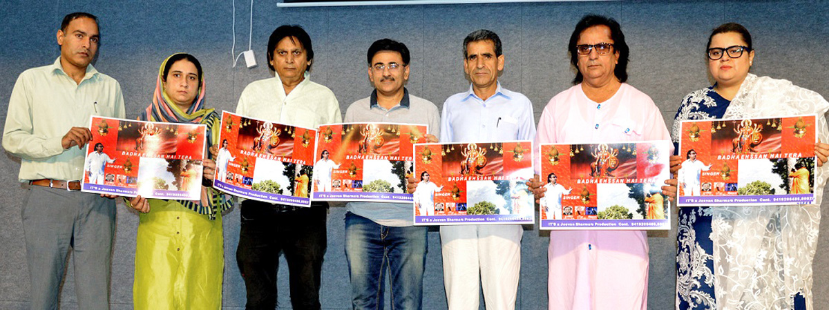 Director Information Gulzar Ahmed Dar and other dignitaries during release of Jeevan Sharma's devotional songs album on Friday.