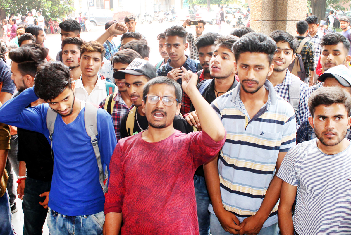 Students protesting against hike in revaluation and re-examination fees at JU in Jammu. -Excesior/ Rakesh