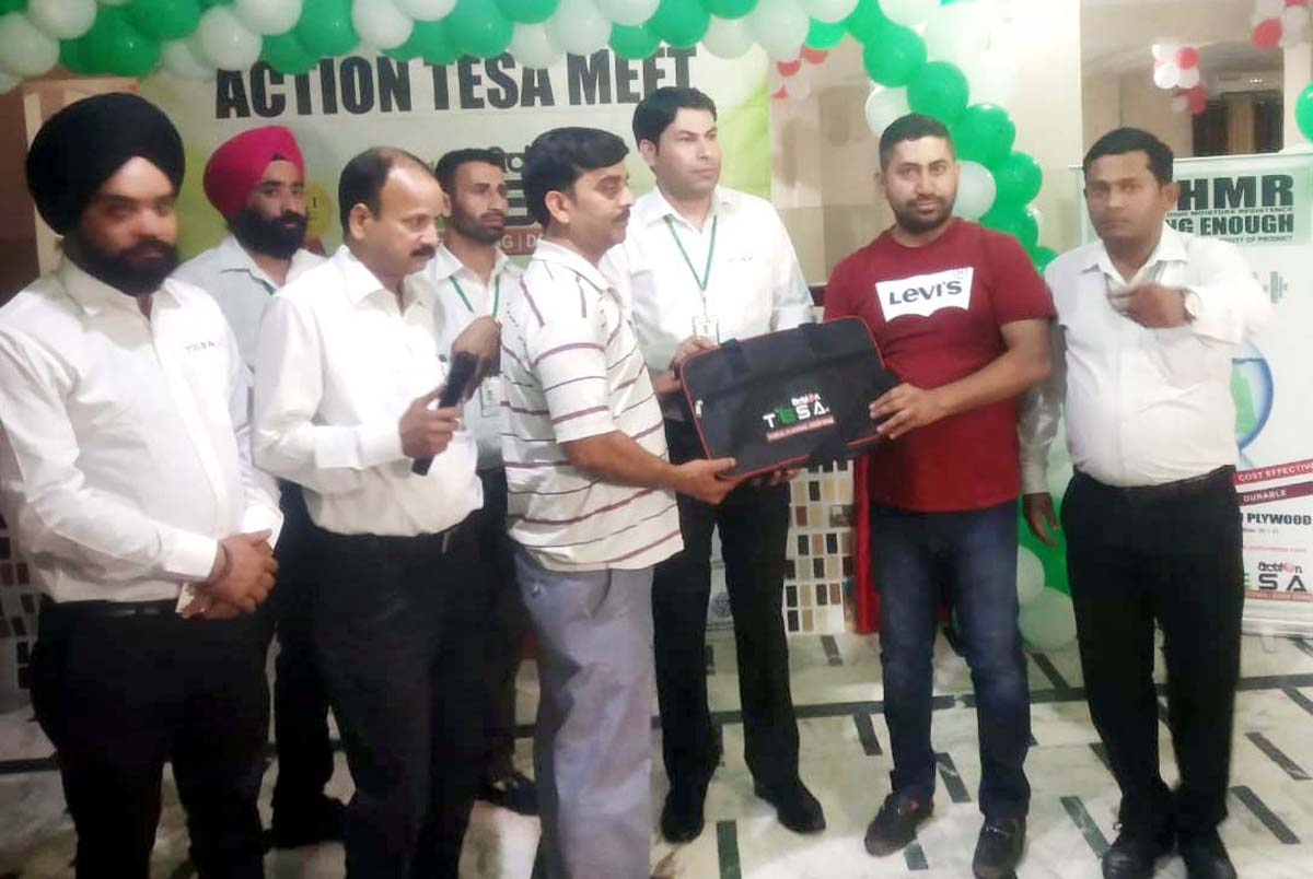 Officials of Action Tesa presenting gift to a contractor at Udhampur.