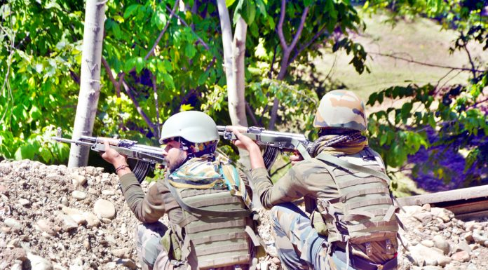 Troops at the site of encounter at Kokernag in Anantnag on Tuesday. -Excelsior/Sajad Dar