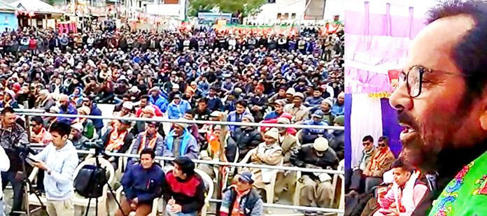 Union Minister, Mukhtar Abass Naqvi addressing a mammoth election rally at Kargil on Wednesday. —Excelsior/Basharat Ladakhi