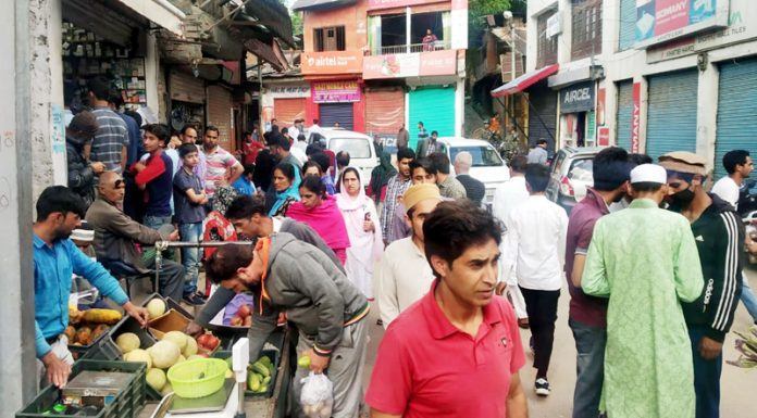 People shopping in Bhaderwah town during relaxation of curfew on Sunday.