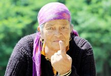 An elderly voter showing her inked finger after casthing vote at Kullu on Sunday. (UNI)