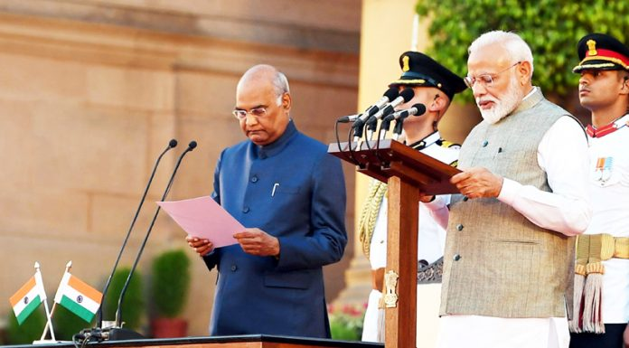 President Ram Nath Kovind administering the oath of office of the Prime Minister to Narendra Modi at a swearing-in ceremony at Rashtrapati Bhavan, in New Delhi on Thursday.
