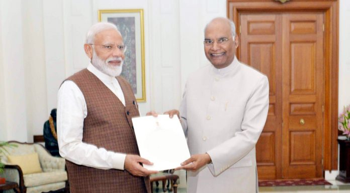 President Ram Nath Kovind handing over appointment letter of PM to Narendra Modi at Rashtrapati Bhavan in New Delhi on Saturday. (UNI)