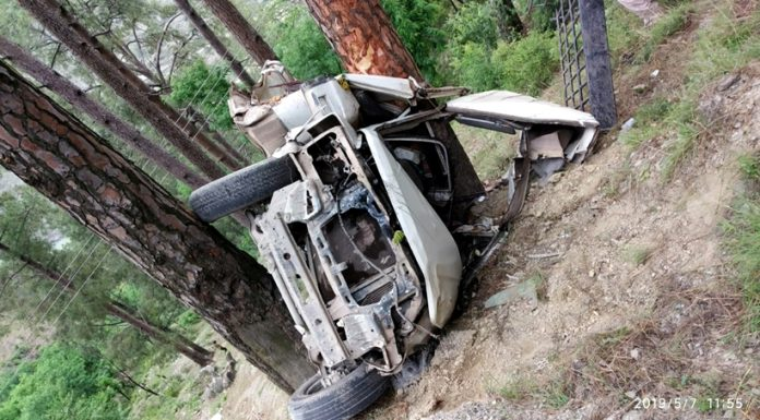 Wreckage of ill-fated Tata Sumo after accident in district Ramban.