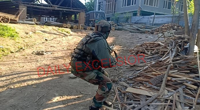 An Army jawan takes position during encounter in Kulgam on Wednesday. —Excelsior/Sajad Dar