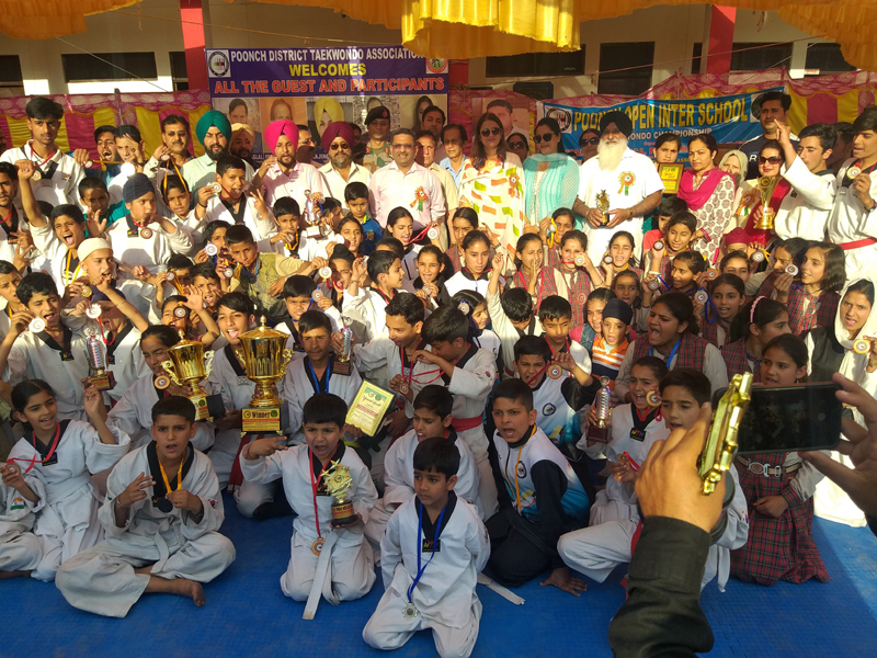 Winners posing for a group photograph during concluding ceremony of Open Inter-School Taekwondo C'ship in Poonch.