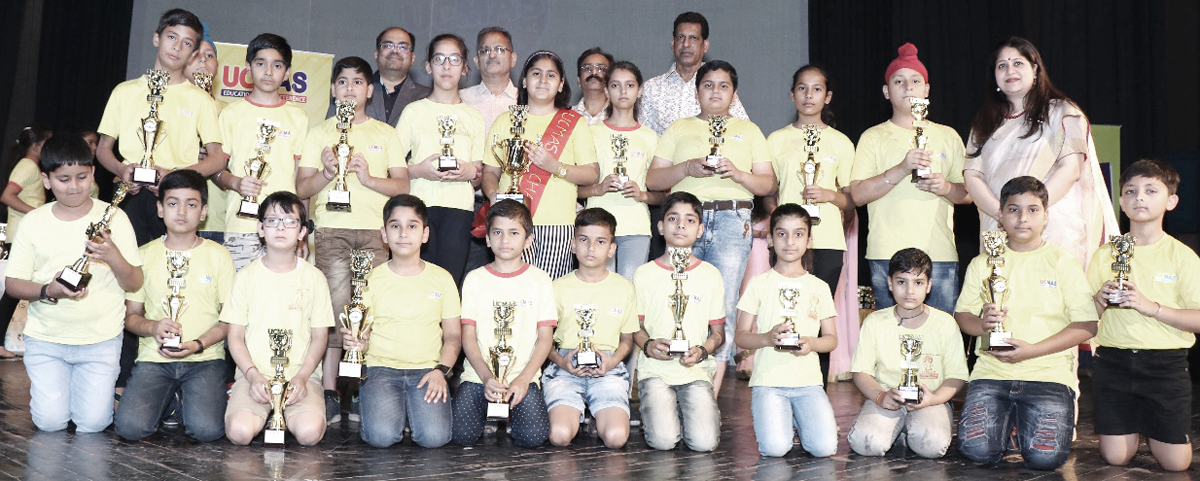 Winners of 9th J&K State Level Prize competition posing for photograph with former DyCM Kavinder Gupta and others at Jammu on Sunday.
