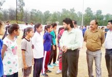 DYSSO Samba, Sunil Kumar interacting with players during inter zone tournament at Maharaja Suchet Singh Stadium in Samba.