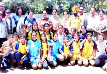 Young players posing along with dignitaries and officials during District Level Inter-Zonal Tournaments in Jammu.