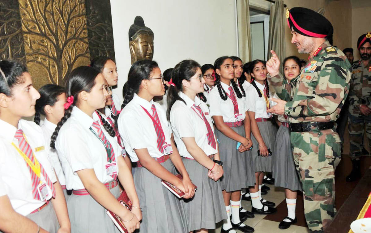 Lt Gen Ranbir Singh, Army Commander Northern Command interacting with students while providing them financial assistance on Monday.