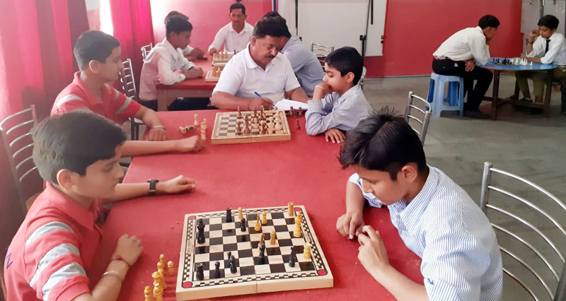 Players in action during Inter-School Chess competition at Sports Stadium in Kathua.