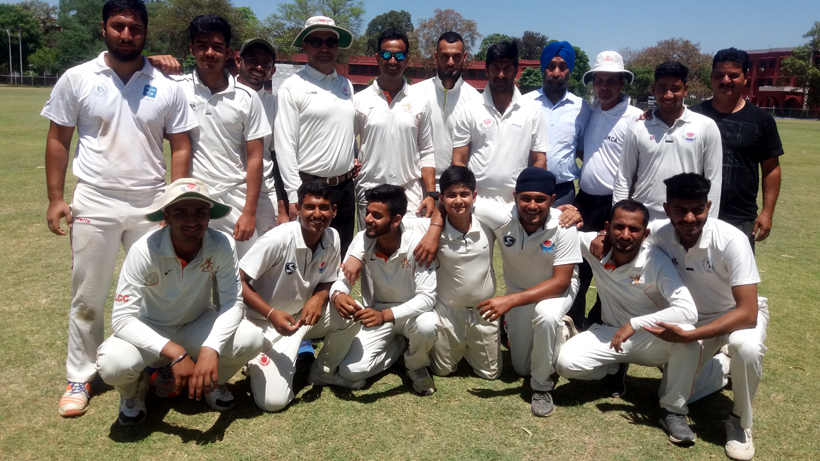 Players of Laxmi Cricket Club posing for a group photograph after scripting win in JKCA's Jammu District Tournament in Jammu.