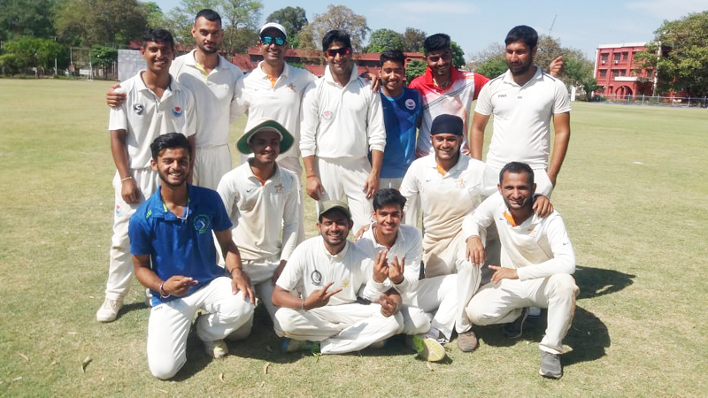 Laxmi Cricket Club players posing for a group photograph after registering win at GGM Science College Hostel ground in Jammu.