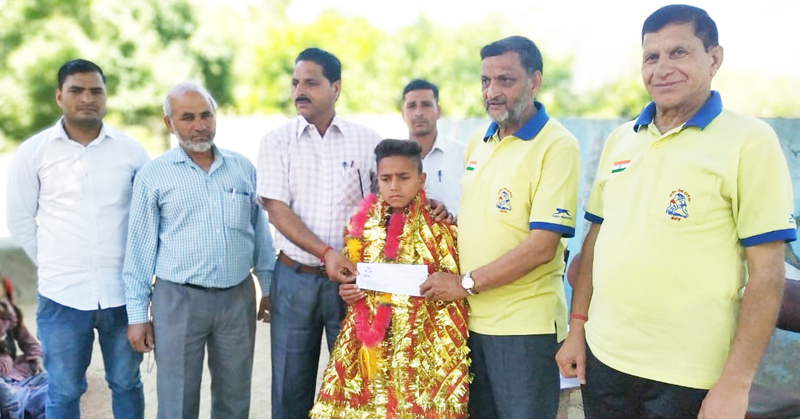 Young Wrestler Ashok Singh being honoured in Reasi.