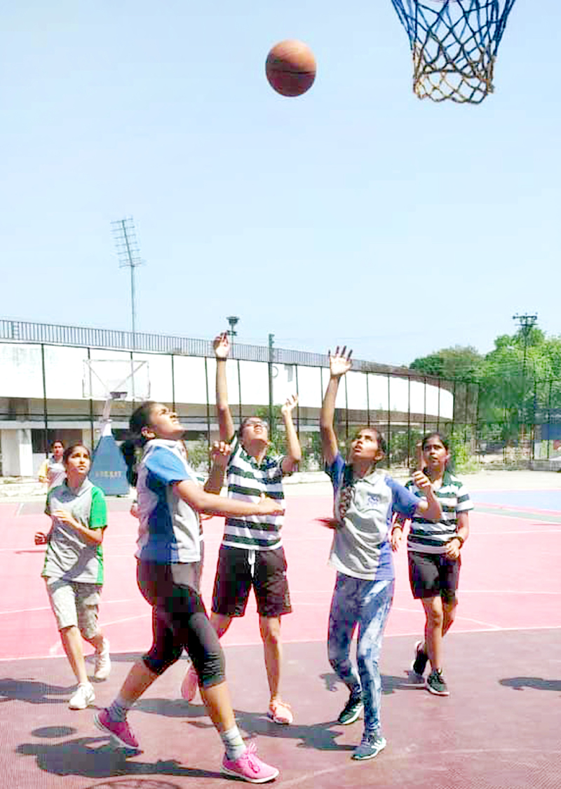 Players in action during Basketball inter-school finals in Jammu.