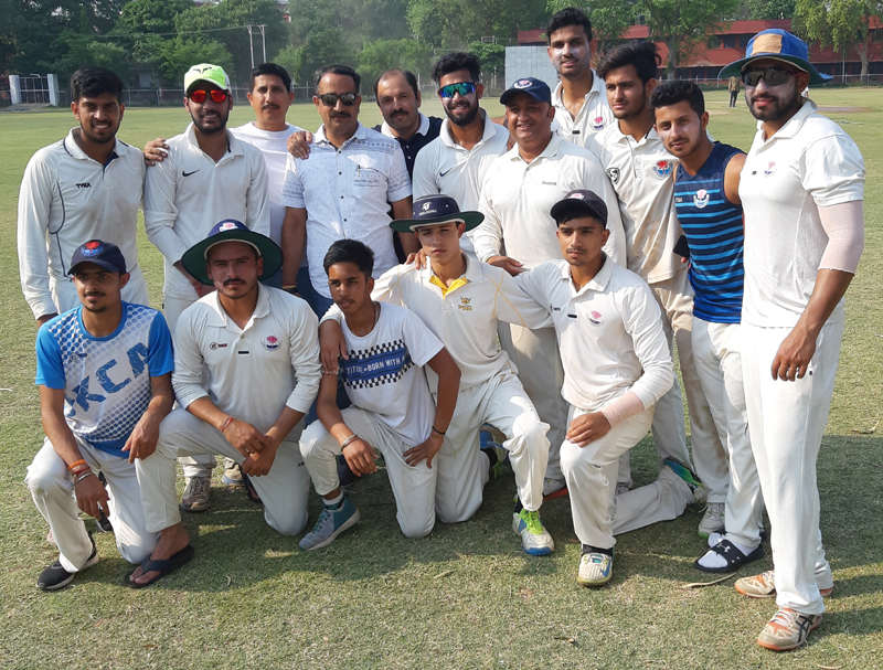 Triumphant KCCC players posing along with their mentor Ankush Abrol, former member BCCI in Jammu on Tuesday.