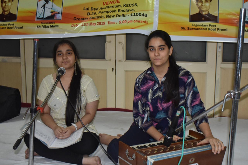 Two young singers paying musical tributes to martyr Sarwanand Koul Premi and renowned singer Vijay Malla at Delhi on Saturday.