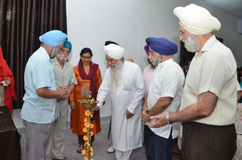 Mahant Manjit Singh and other dignitaries lighting ceremonial lamp to inaugurate Annual Day celebration at SMS College of Education in Jammu.