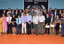Delegates posing along with chief guest and other dignitaries during concluding ceremony of MUN at KC Public School.