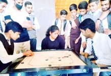 Players in action during a Carrom match at Sher-e-Kashmir Indoor Stadium in Srinagar.