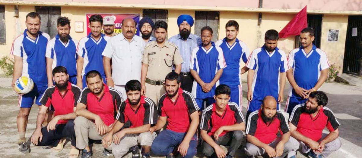 Superintendent, District Jail Kathua, Mushtaq Ahmed Malla and other officers posing with Volleyball teams in Jail complex.