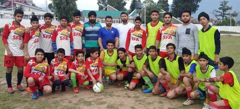 Young footballers' posing with officials at Sports Stadium, Poonch on Wednesday.