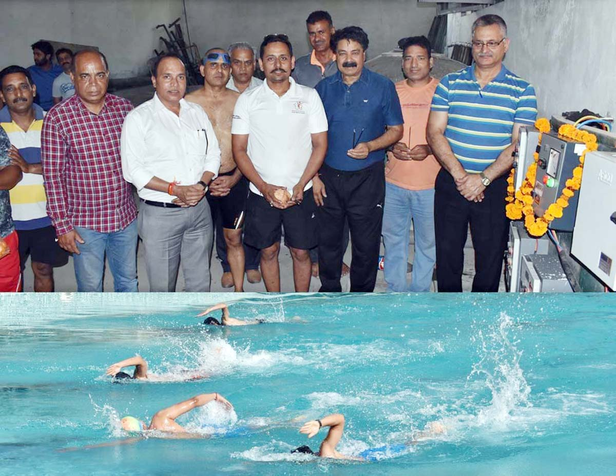 Ravi Singh, Divisional Sports Officer, J&K State Sports Council, Jammu along with other officers inaugurating swimming pool at MA Stadium, Jammu.