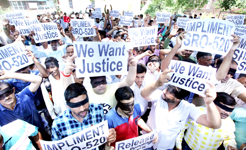 PHE daily wagers taking out protest march in Jammu on Monday. -Excelsior/Rakesh