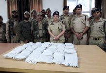 SSP Ramban Anita Sharma along with other cops displaying 30 kilograms Pakistan smuggled heroin seized by Banihal Police. —Excelsior/Parvaiz
